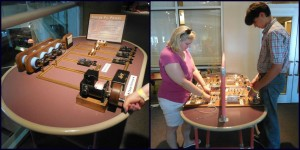My mom and brother experimenting with power in the Science Phenomena exhibit at the Great Lakes Science Center.