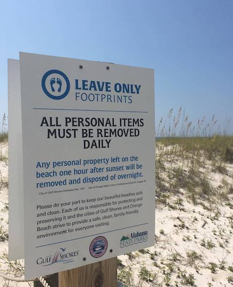Leave Only Footprints sign reminding beach goers to take their things home