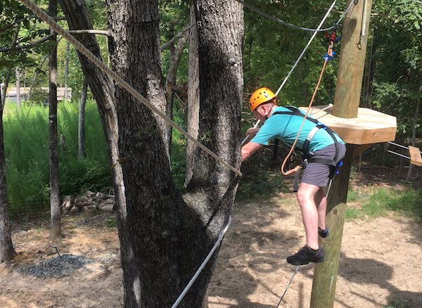 Facing obstacles on a high ropes course can be tough