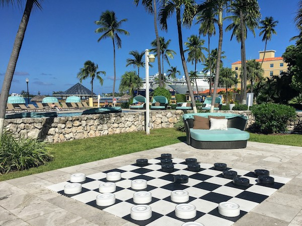 Giant checkers and luxury loungers are included in a Hilton hotel day pass in Nassau
