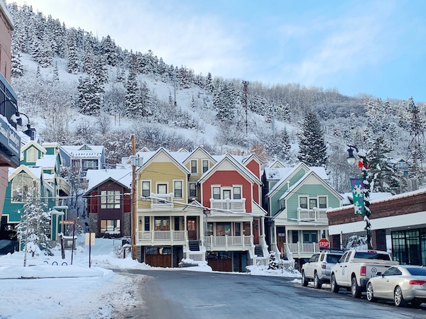 Downtown Park City with snow covered mountains in the background