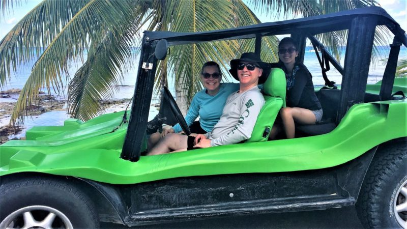 Photo of us in the dune buggy at the beach in Cozumel