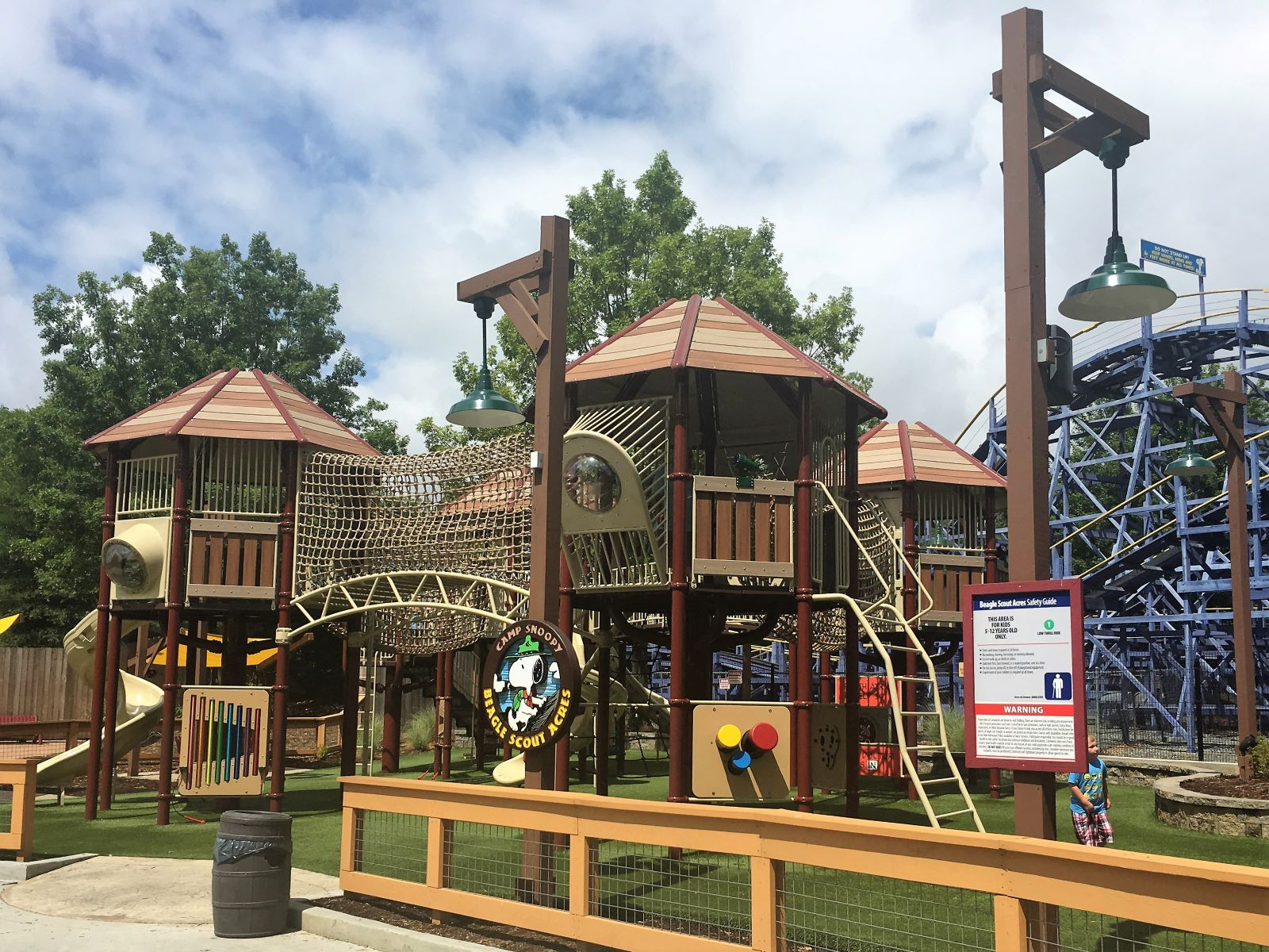 Camp Snoopty playground at Carowinds with slides, climbing nets and other free play
