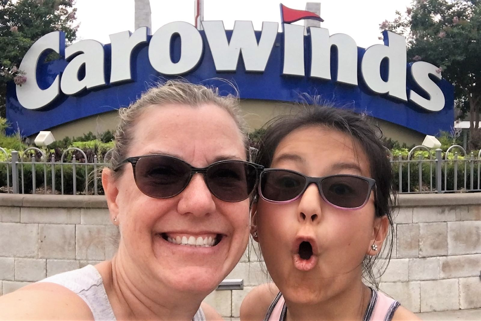 Ellie and me in front of the Carowinds sign