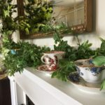 Fireplace mantle with tea cups at the Rosemont Inn Bed and Breakfast