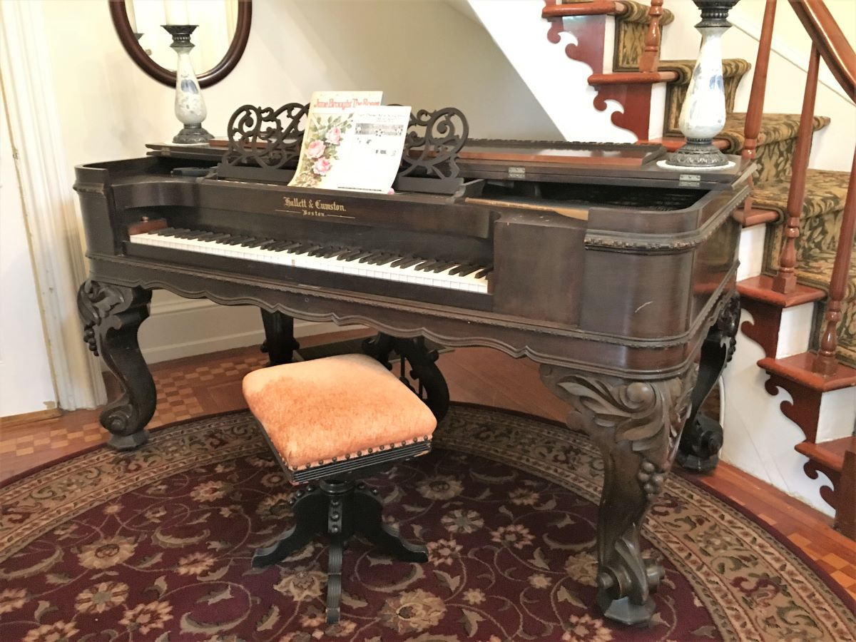 Antique piano in the foyer by the grand staircase
