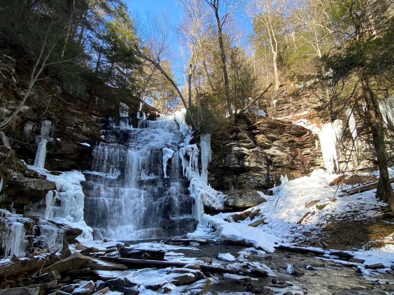 Ice hiking at Ricketts Glen falls trail in winter