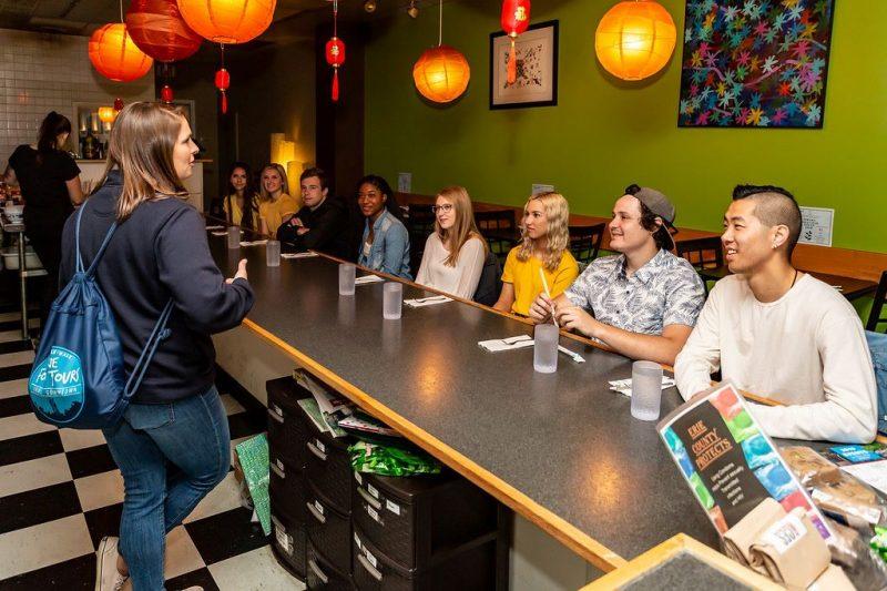 Erie Food Tours group enjoying a storyteller.