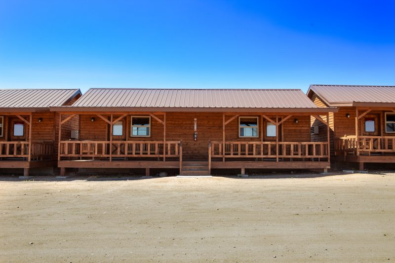 Hualapai cabins at Grand Canyon West, rustic accommodations that offer a chance to unplug and reconnect with each other and with nature. Great sunset views over the Grand Canyon from the porches.