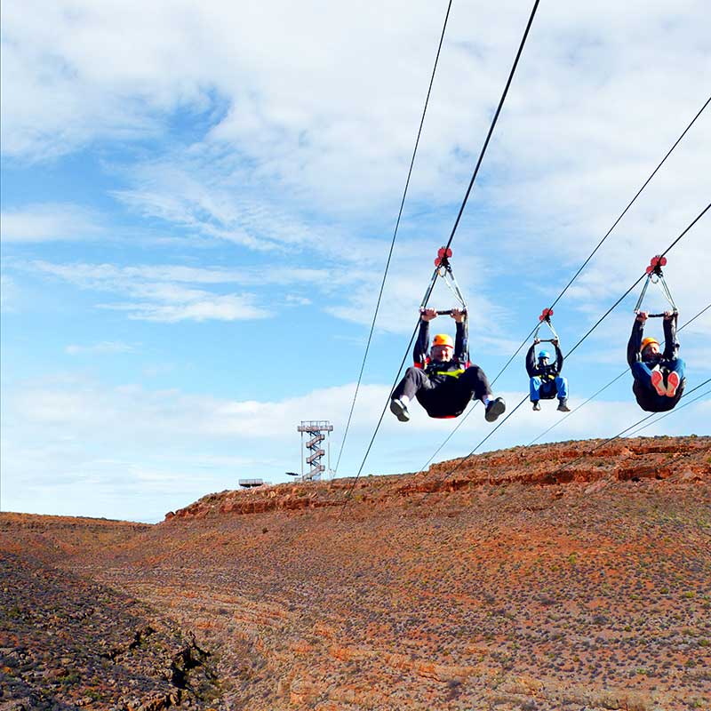 Ziplining at Grand Canyon West, an activity provided by the Hualapai tribe for Grand Canyon vacations for families